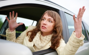 Angry young woman stuck in a traffic jam